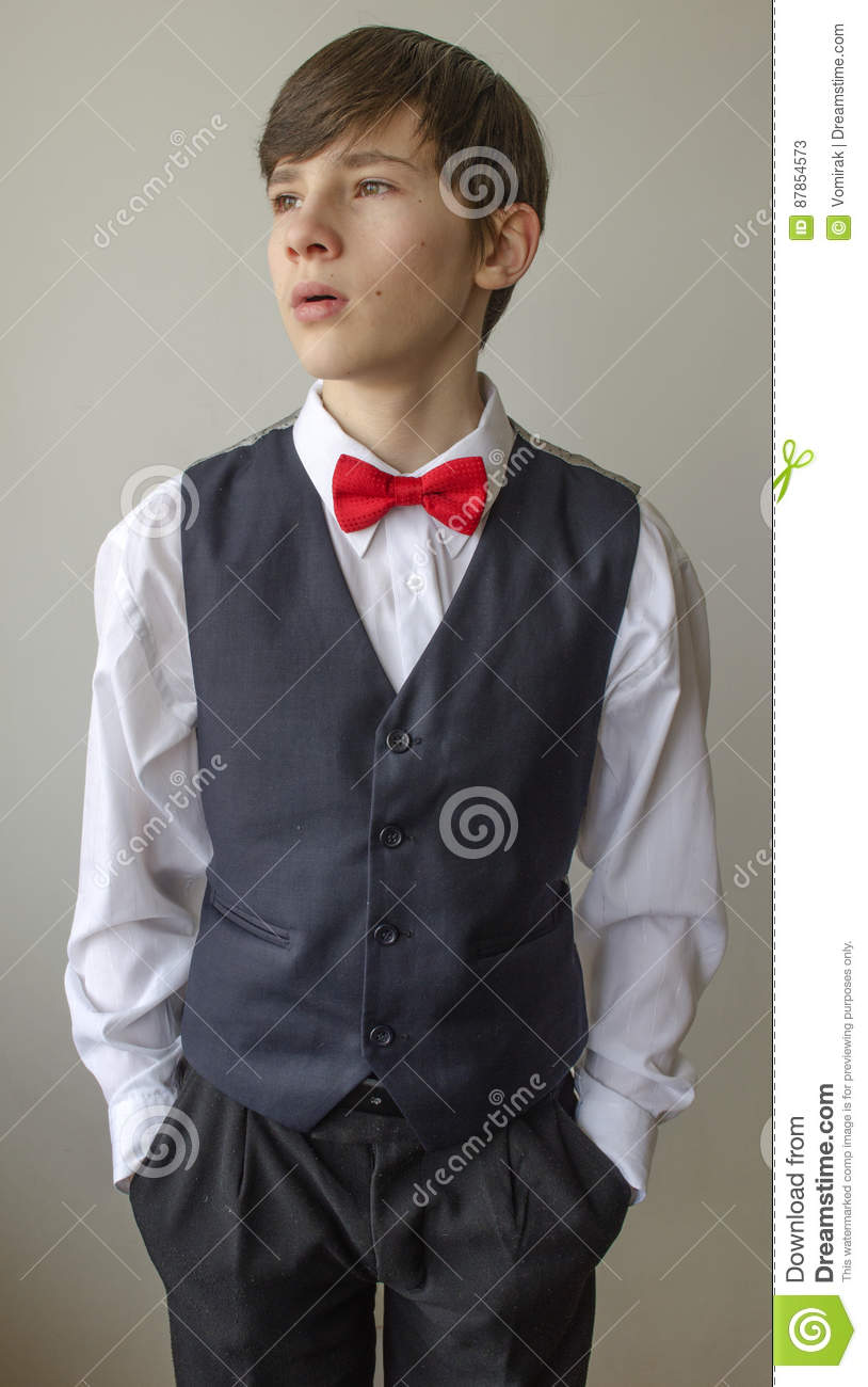 Teenager Boy In A White Shirt And A Waistcoat With The Red