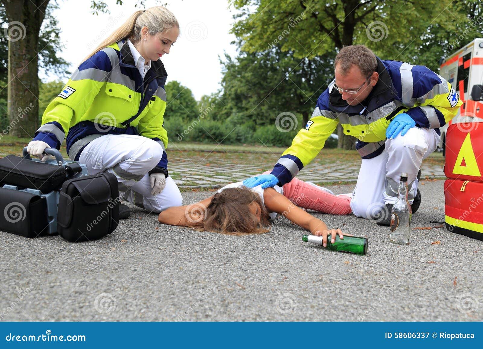 Teenager drunken on floor with paramedic