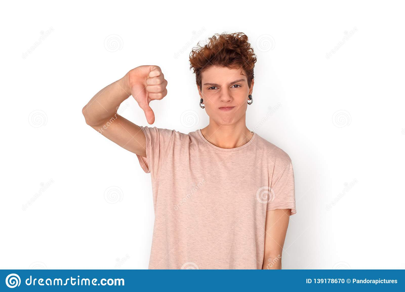c7166916acbb7 Teenager With Earrings Studio Standing Isolated On White Thumb Down ...