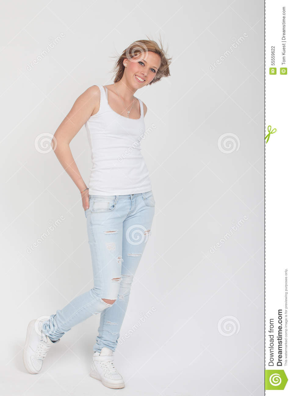 Teenager Girl In Blue Jeans, White Shirt And White Sport Shoes P ...