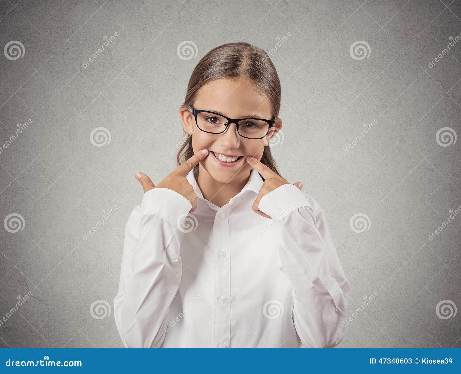 Teenager girl making fake smiling face