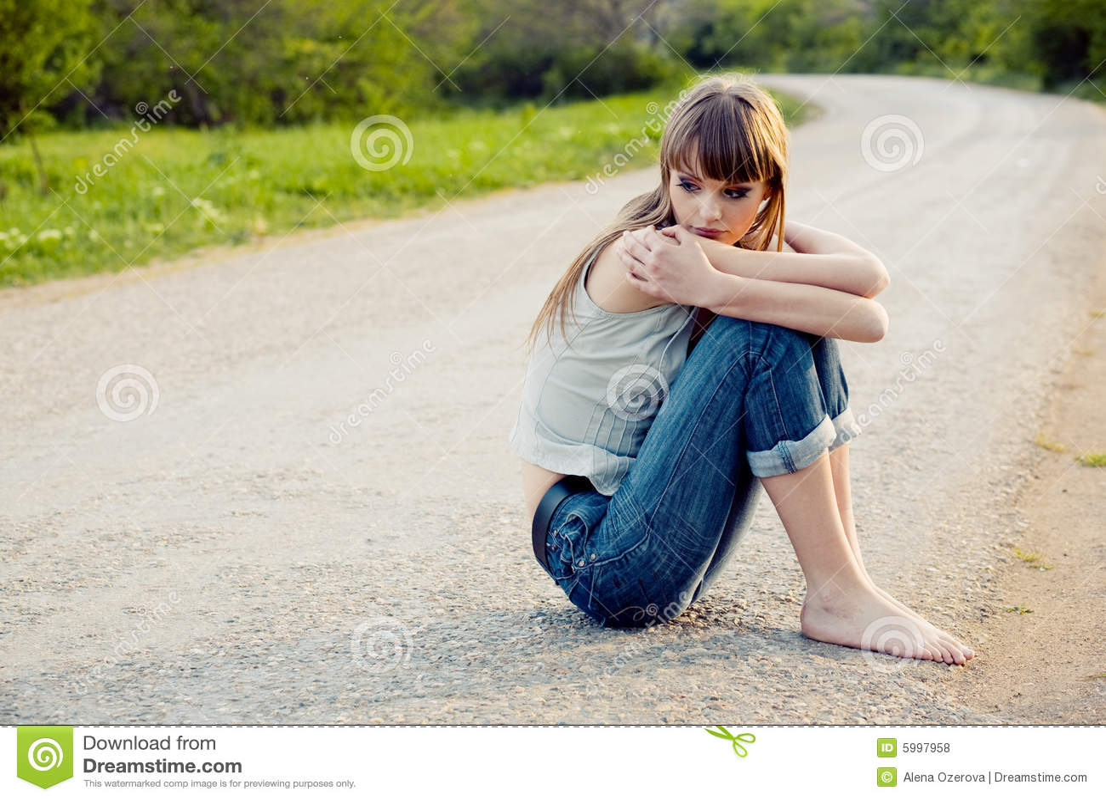 Teenager Girl Sitting On Road Stock Photo - Image: 5997958