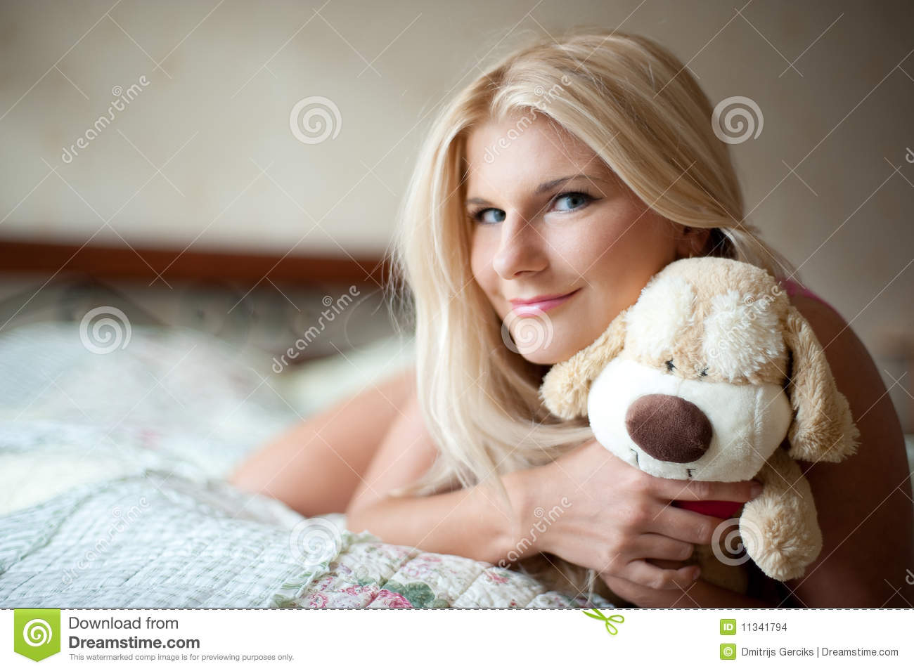 Gril Toy For Teenager : Teenager girl with toy on her bed stock images image