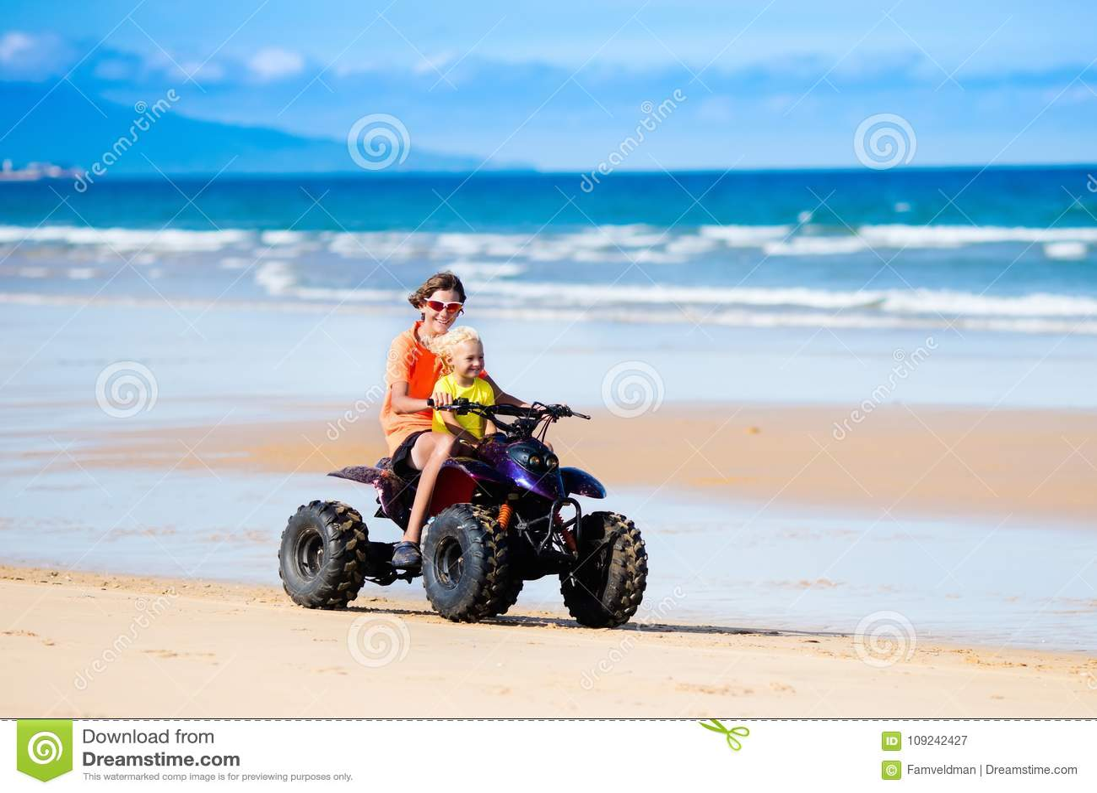 Kids On Quad Bike  Off Road All Terrain Vehicle  Stock Image
