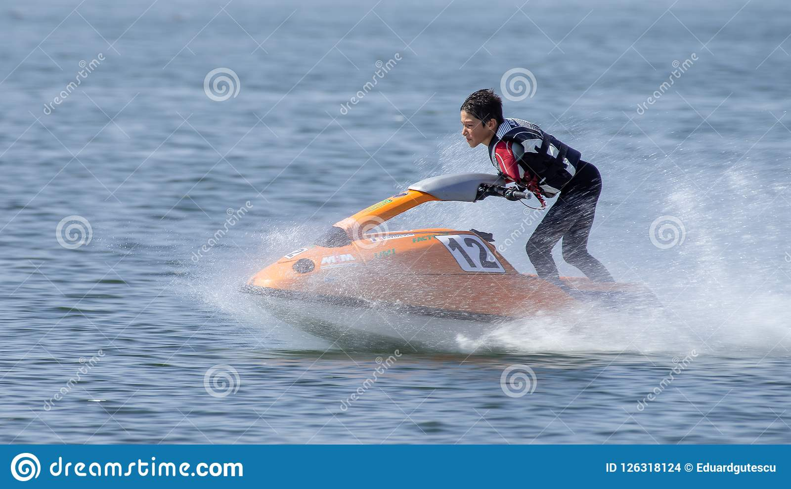 Teenager on Jet Ski-Water Sports in the summer having fun on the beach