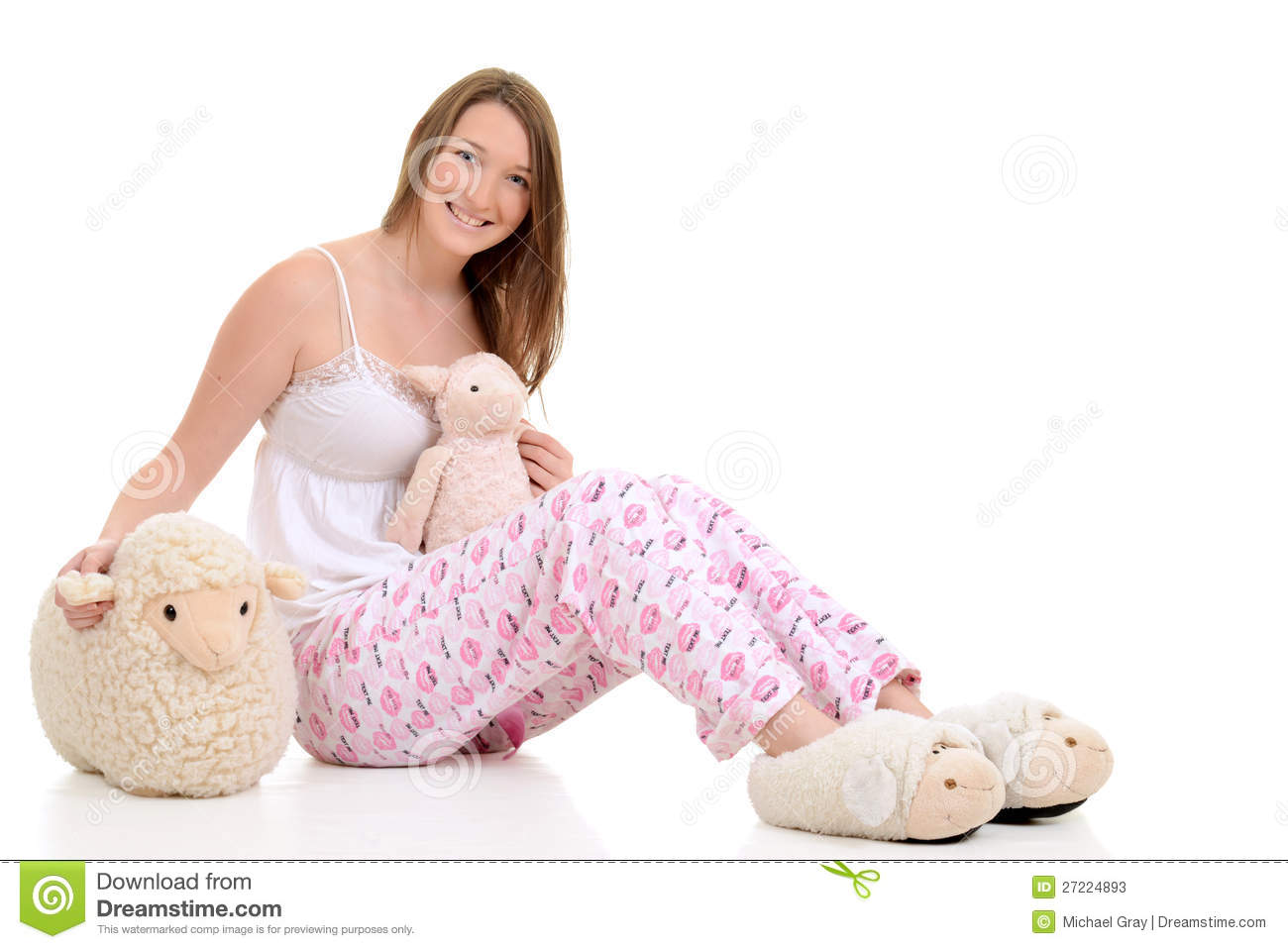 Gril Toy For Teenager : Teenager in pajamas with toy sheep stock image