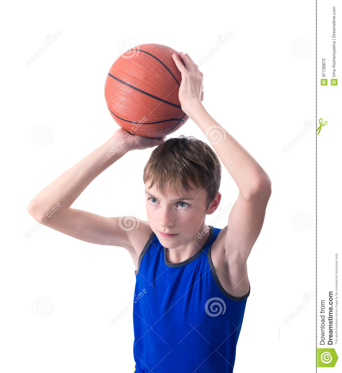 Teenager preparing to throw the ball for basketball. Isolated on white background