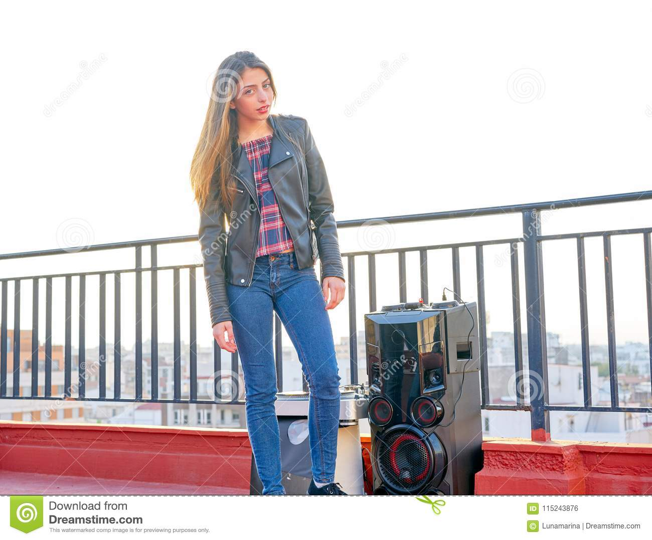 Teenager girl standing outdoor at roof terrace