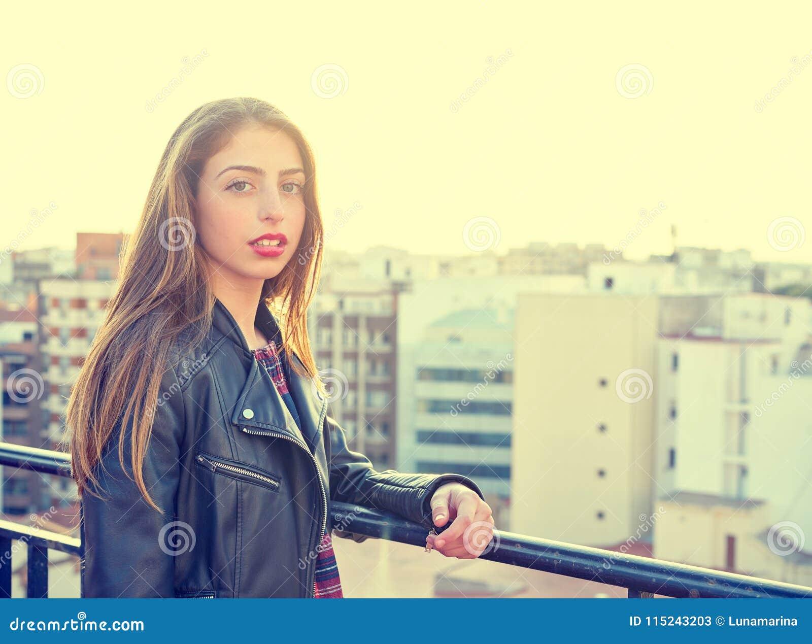 Teenager rock girl standing outdoor at roof terrace