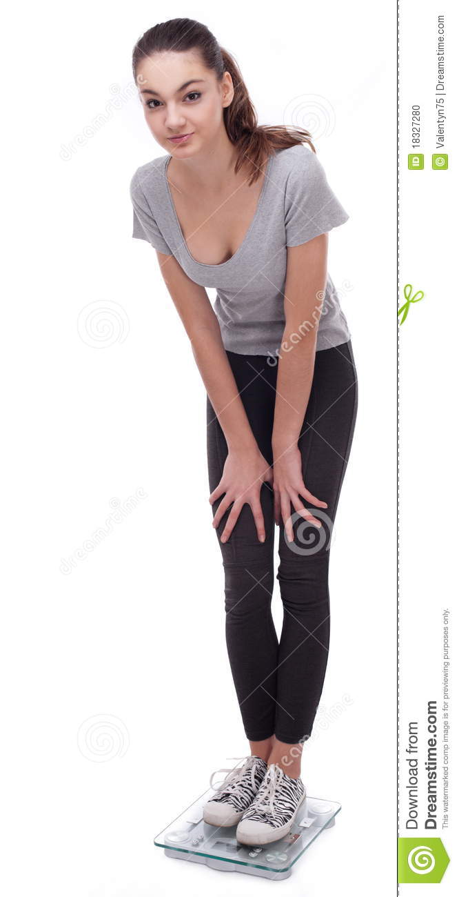 teenager standing on scales stock photo   image 18327280