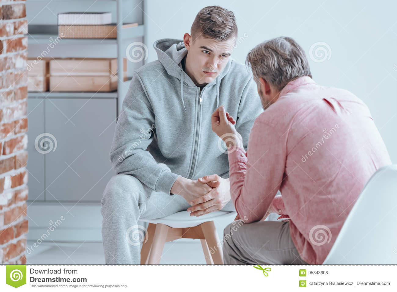 Teenager talking with counselor