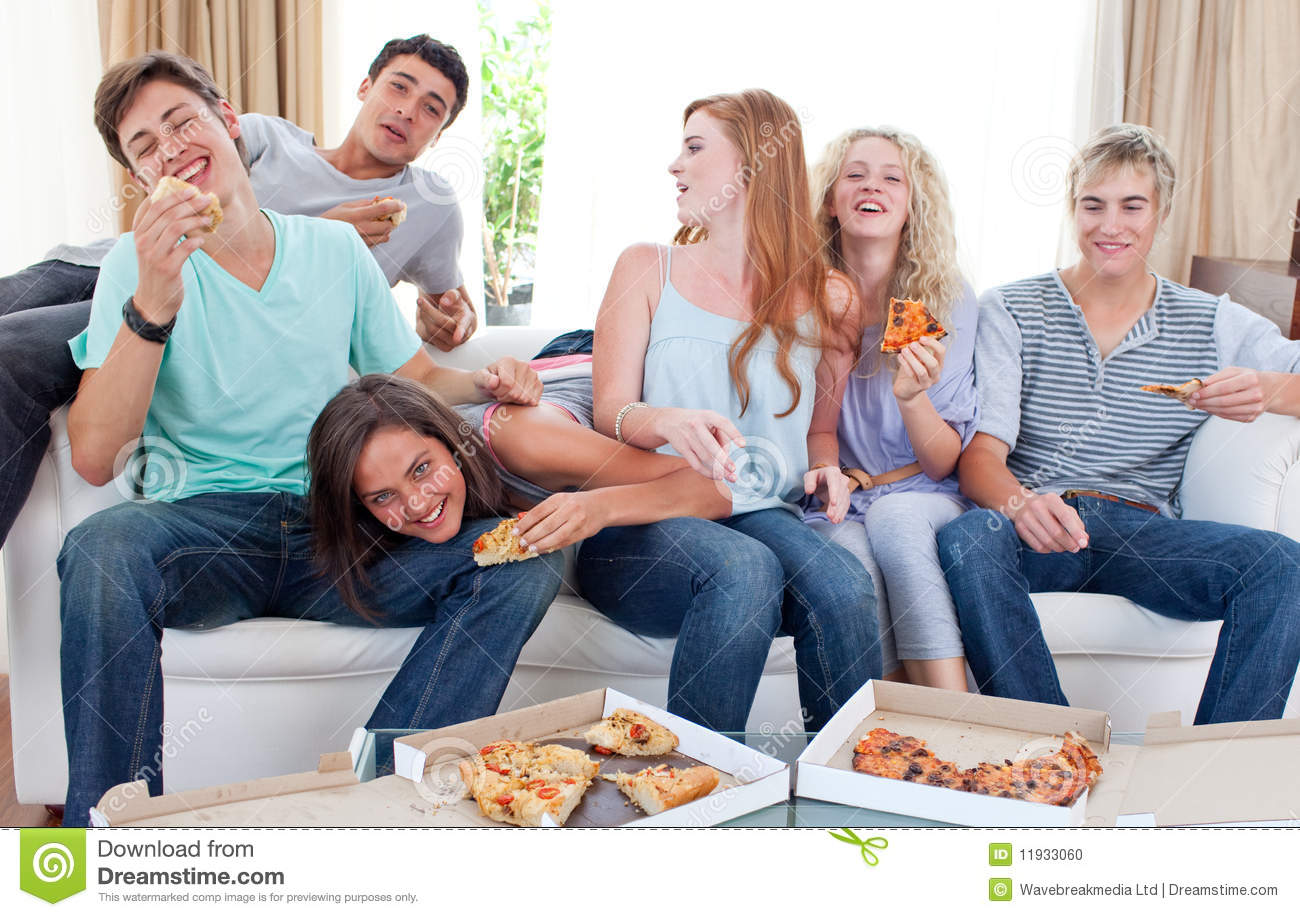 Teenagers Eating Pizza At Home Stock Photo - Image: 11933060