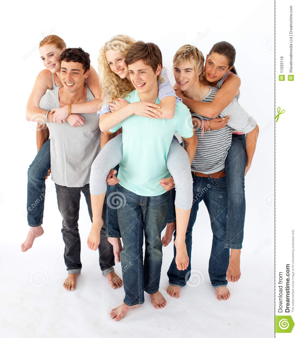 Teenagers Giving Their Friends Piggyback Rides Stock Photo