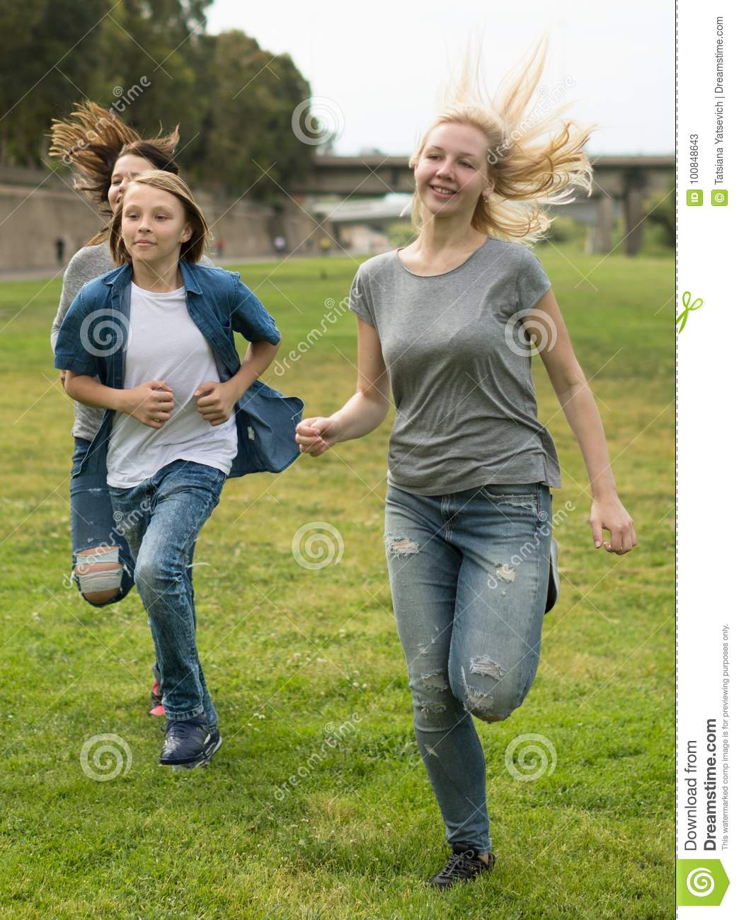 Download Teenagers Running Through Green Lawn In Summer In Park Stock Image - Image of green, brother: 100848643