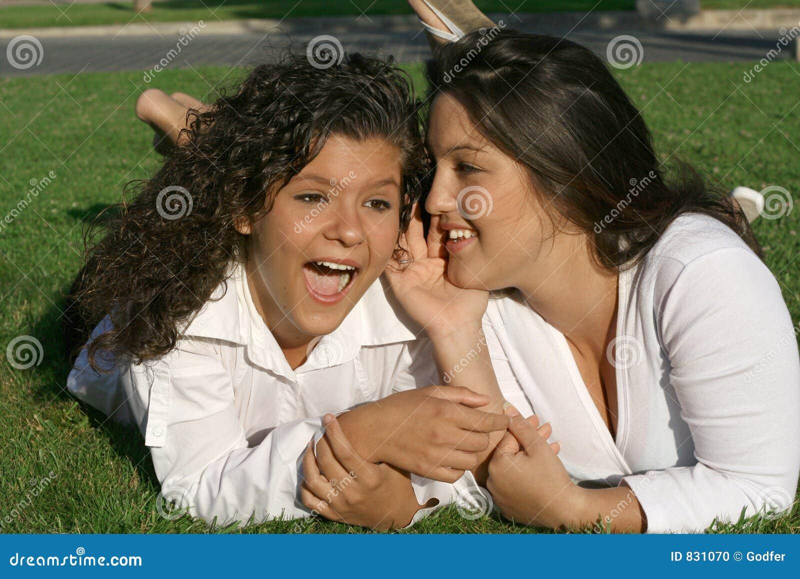 teenagers whispering