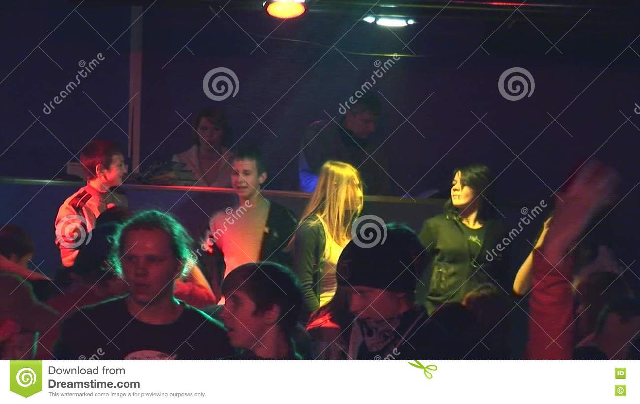 Teens Dancing On Discotheque In Rural Club Small Stage Adult Man DJ Spotlights Entertainment Stock Footage
