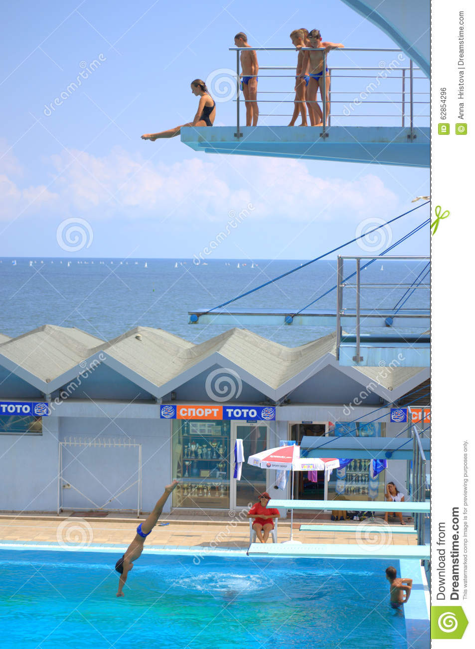 Teens on diving boards editorial photo. Image of class - 62854296