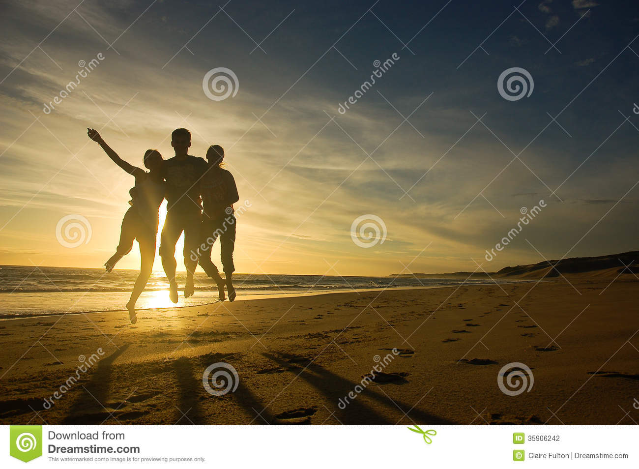 Teens jumping against sunset