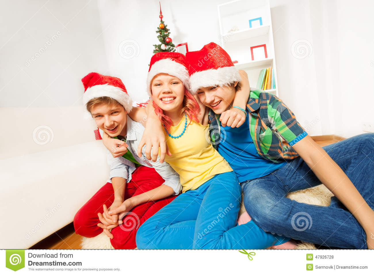 Teens Kids On Christmas Party In Santa Hats Stock Photo - Image ...
