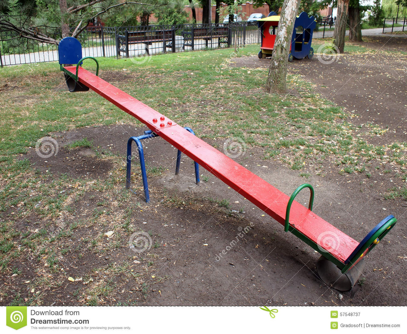 Teeter red color on the playground stock photo image for Seesaw plans designs