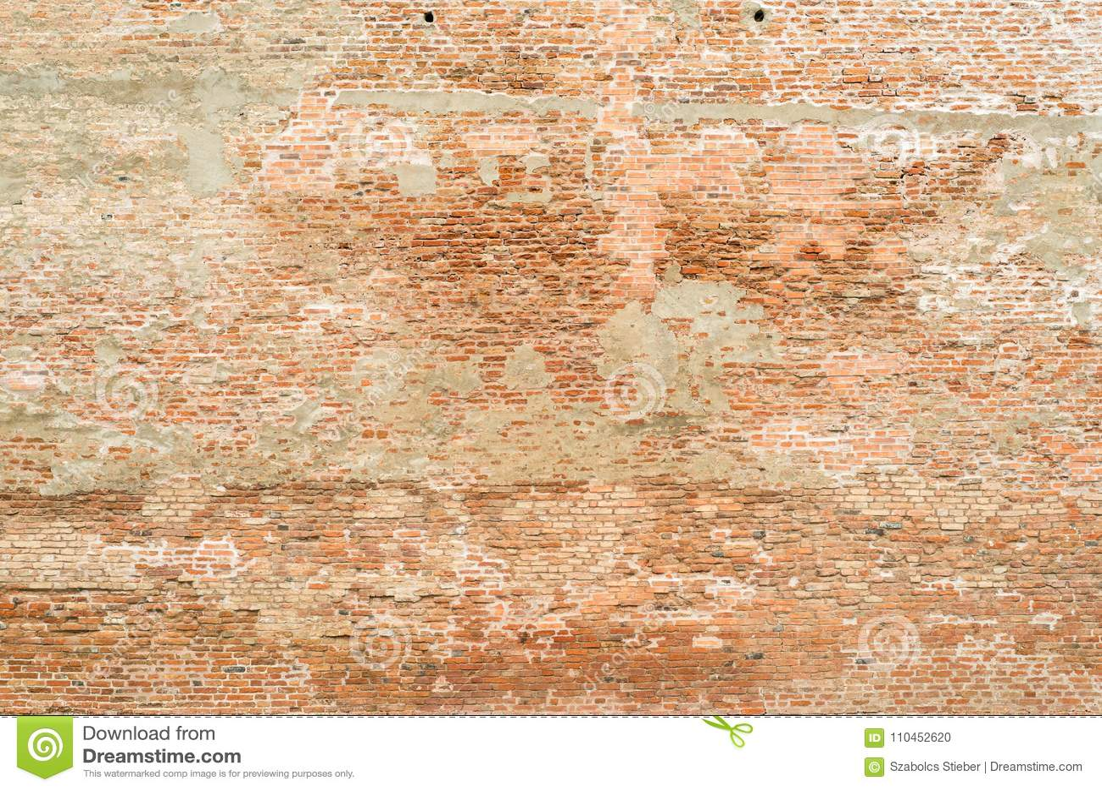 Tegelstenväggen texturerar för bakgrund