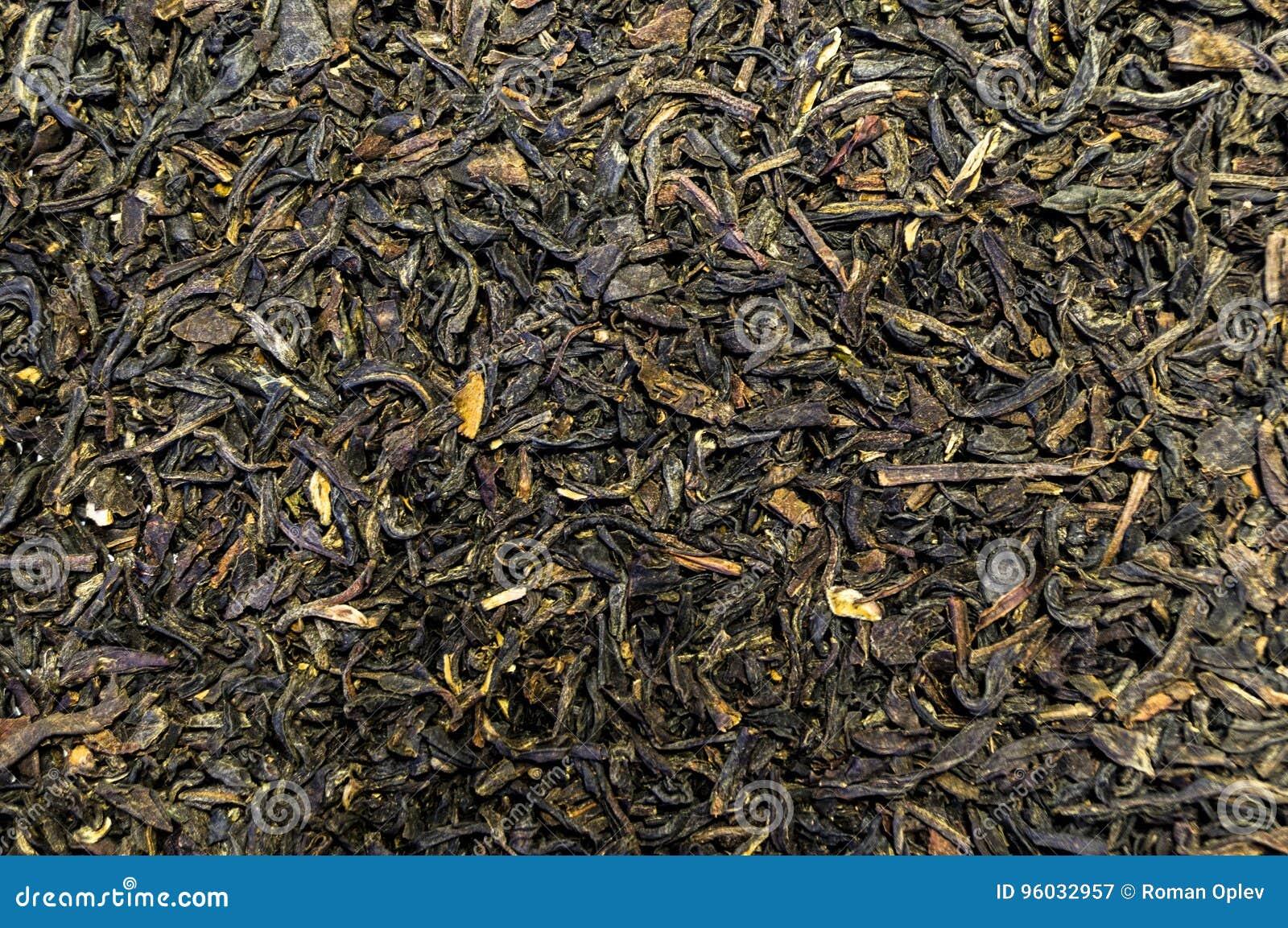 Tekstura herbata rozpraszał na stołowej powierzchni