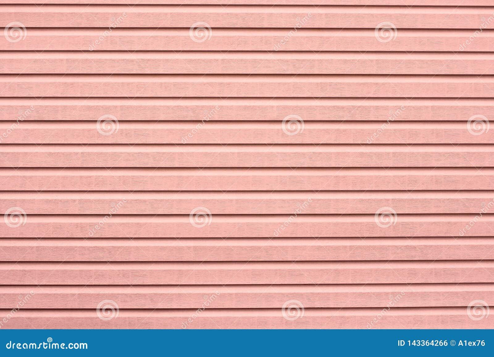 Tekstura malująca w koralowym kolorze drewno