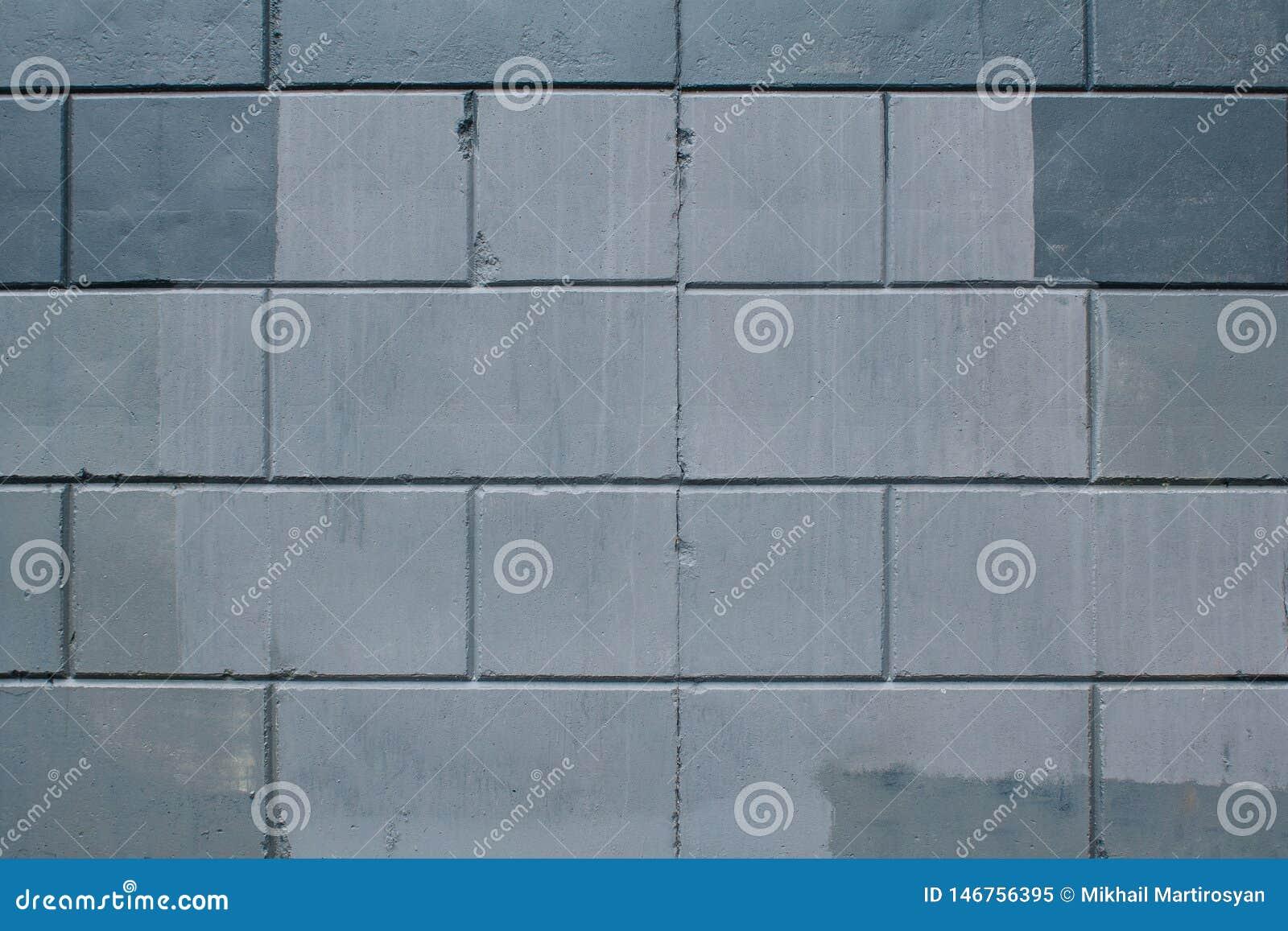 Tekstura szarzy betonowi bloki z plu?ni?ciami czerwie? w szwach