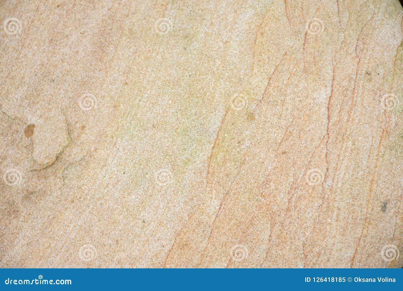 Tekstura wielki piękny gładzi kamień na dennym brzeg