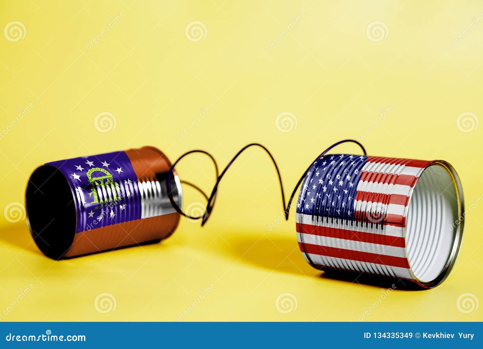 Teléfono de la lata con los E.E.U.U. y Georgia U S Banderas del estado Concepto de la comunicación
