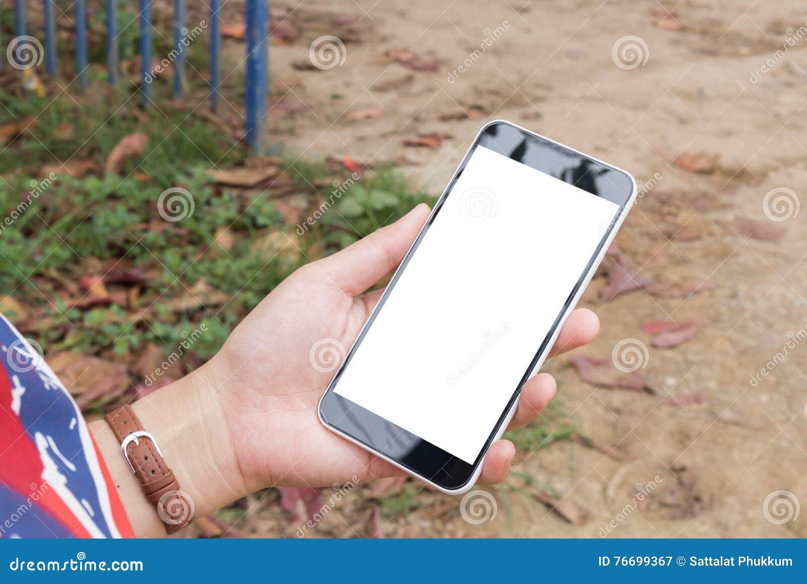 Teléfono elegante del control de la mano de la mujer, tableta, teléfono móvil