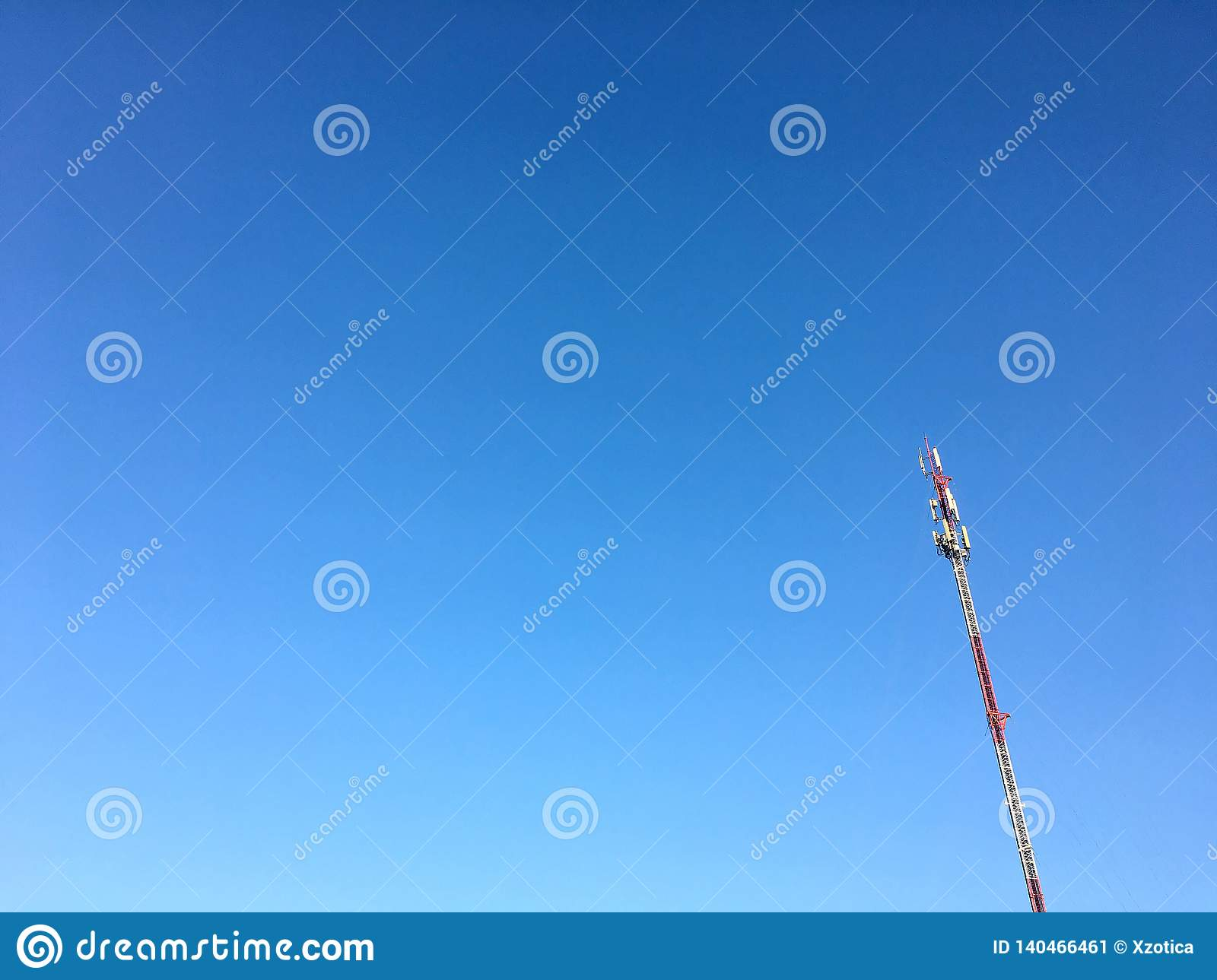 Telecommunication pole with cleared blue sky background