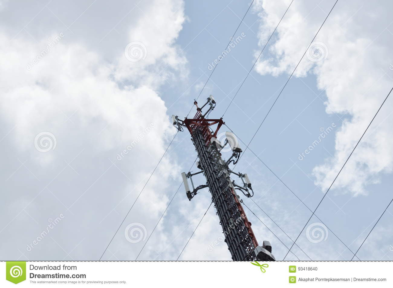 Telecommunication pole on cloud and sky in sunny day