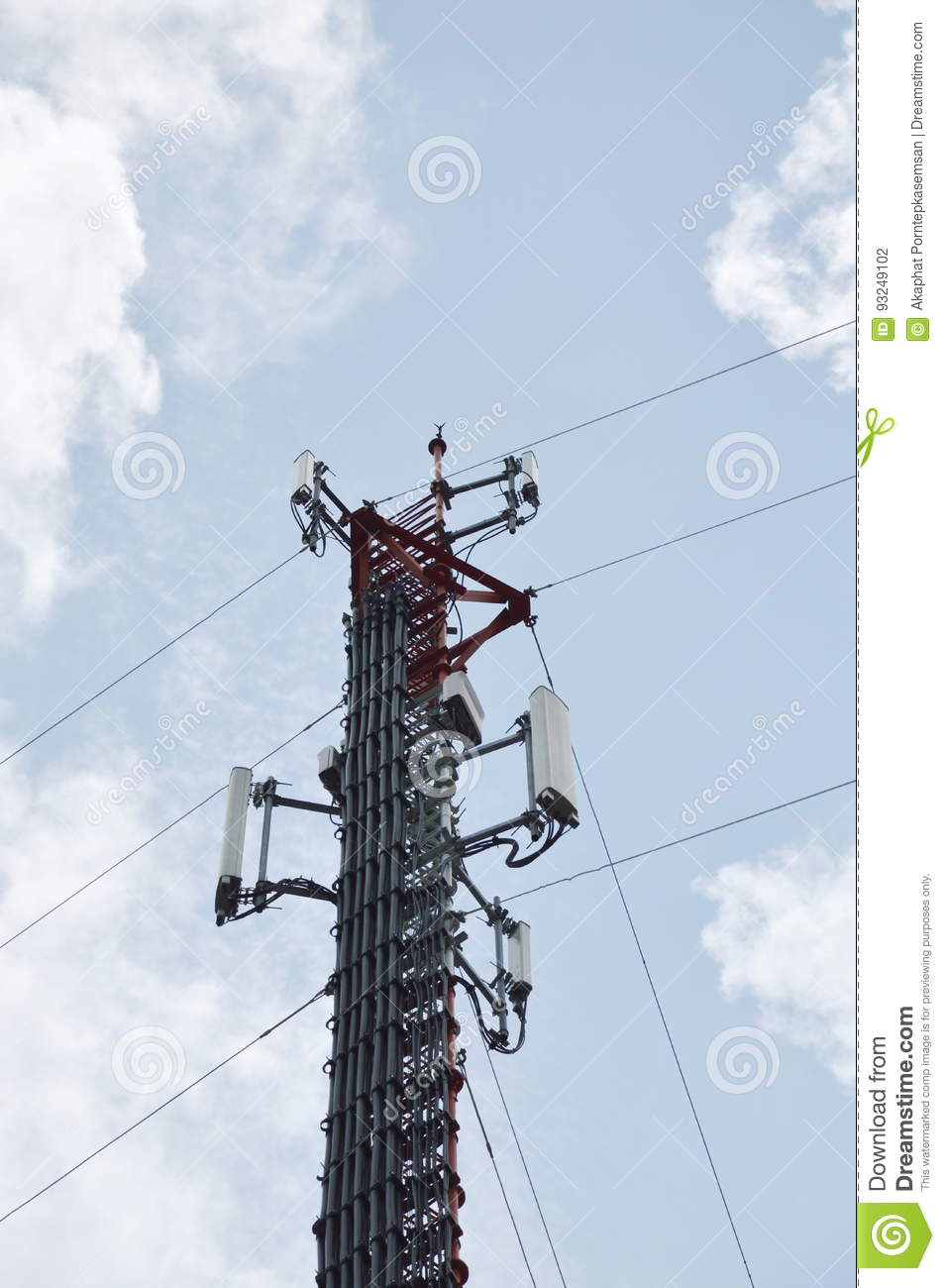 Telecommunication pole on cloud and sky in sunshine day