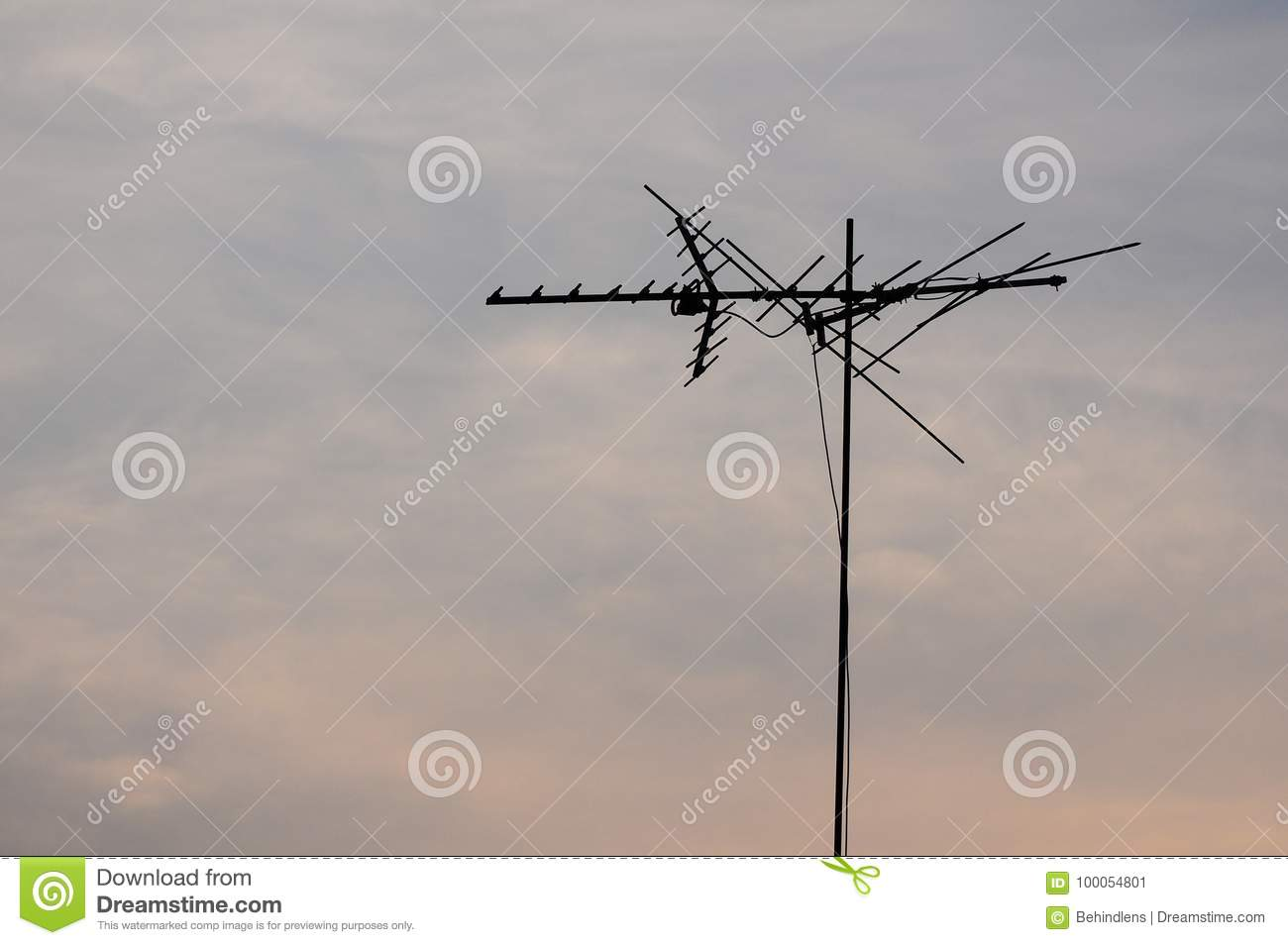 Telecommunication pole with sky at dawn.