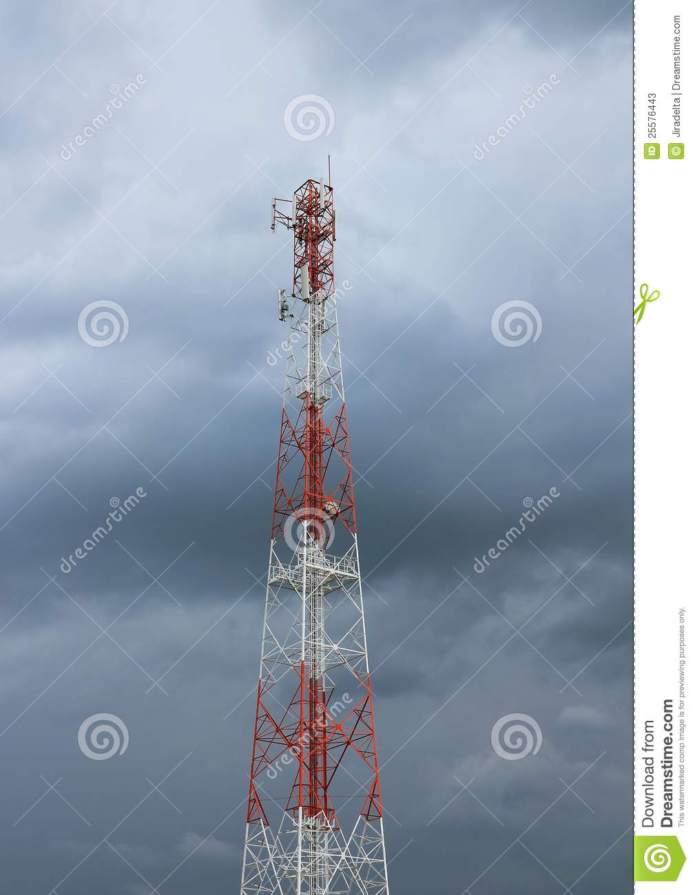 Telecommunication pole tower in cloudy sky
