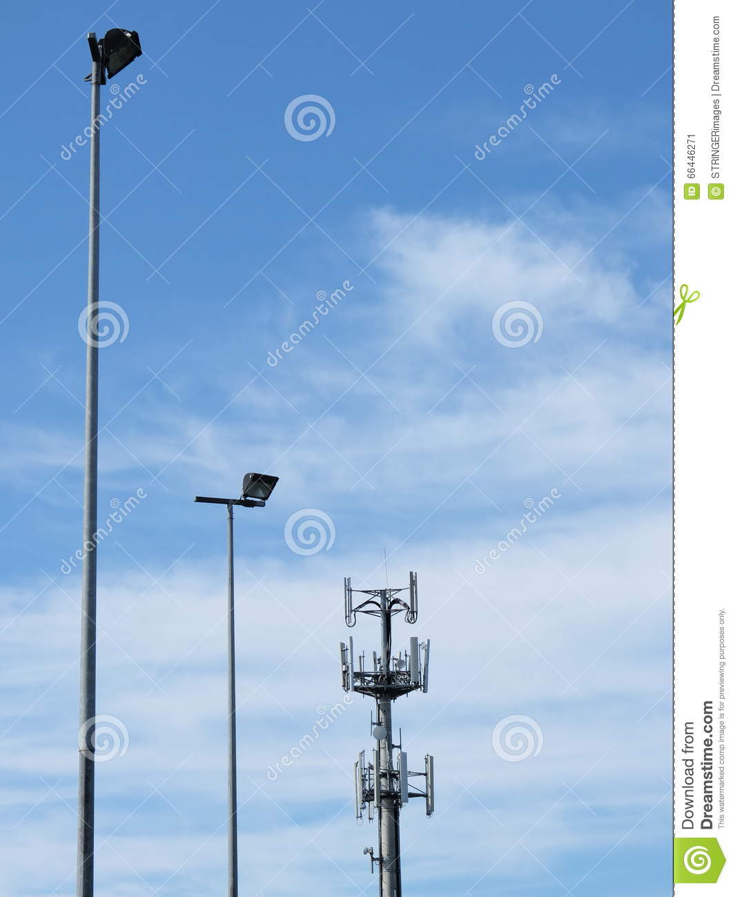 Telecommunications Cell Phone Tower And Light Poles Stock