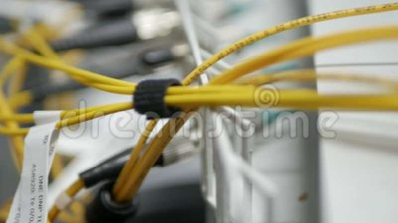 cfac189b442e Technicians are installing optic fiber with cable ties. Global, drawing.