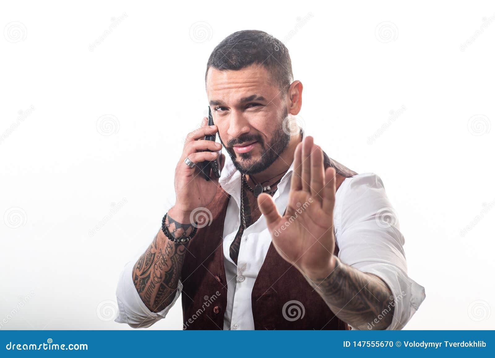 Telefon f?r fr?mre kontor f?r cell f?r ett aff?rsaff?rsmanfelanm?lan som talar till barn Mannen ansade v?l rikt trendigt macho Kl