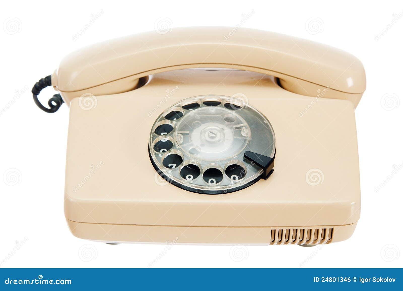 Telefone análogo velho com um disco