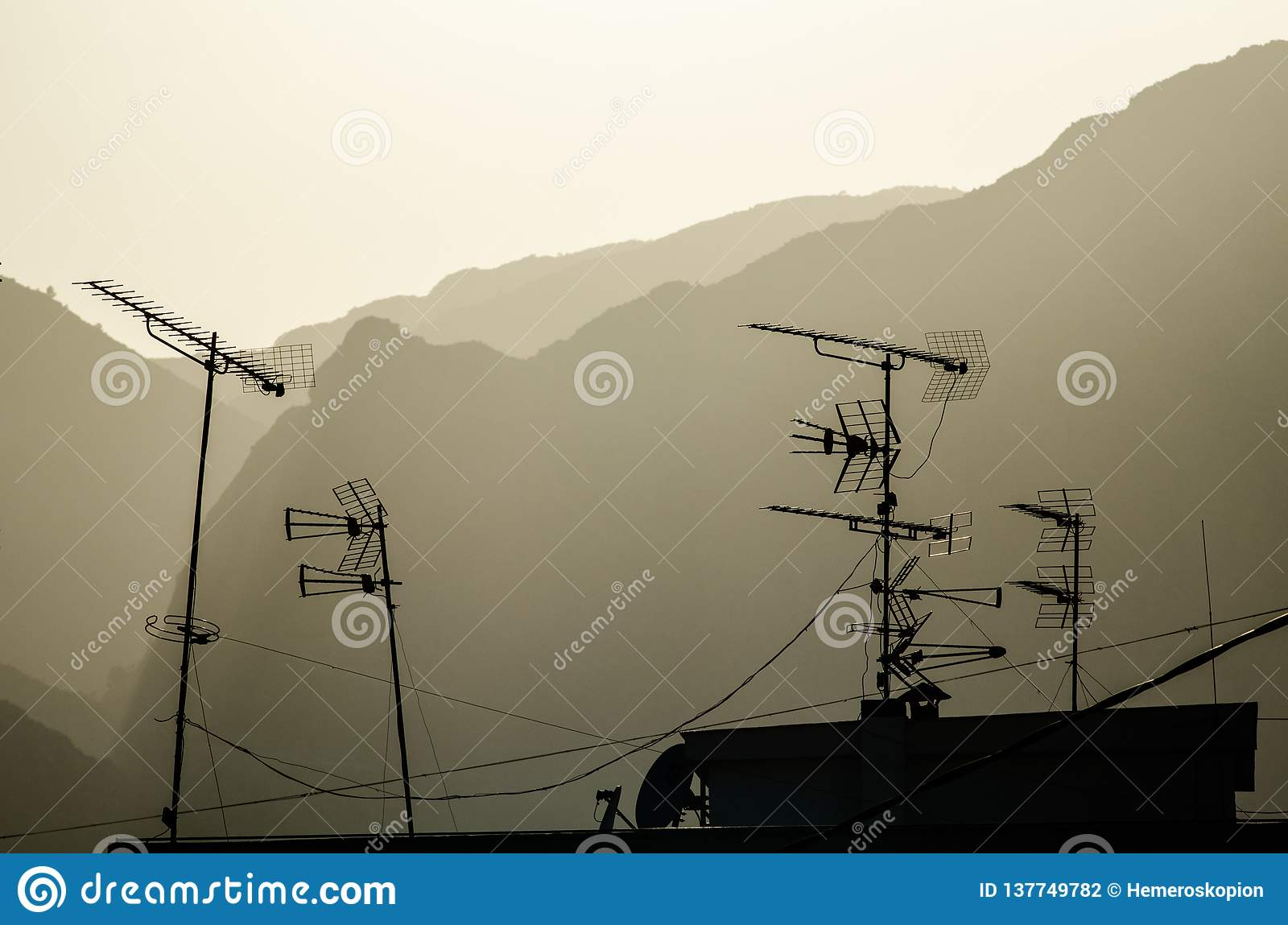 Television antennae on a rooftop