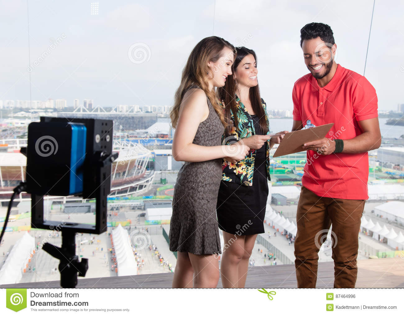 Television Producer Talking With Female Presenters About Tv