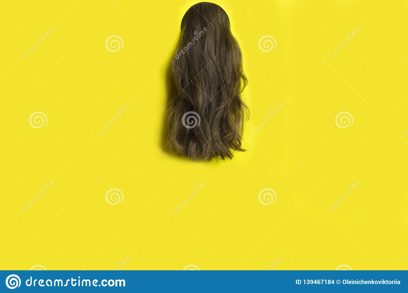Template for hairdresser.Long wavy hair against yellow background,copy space.