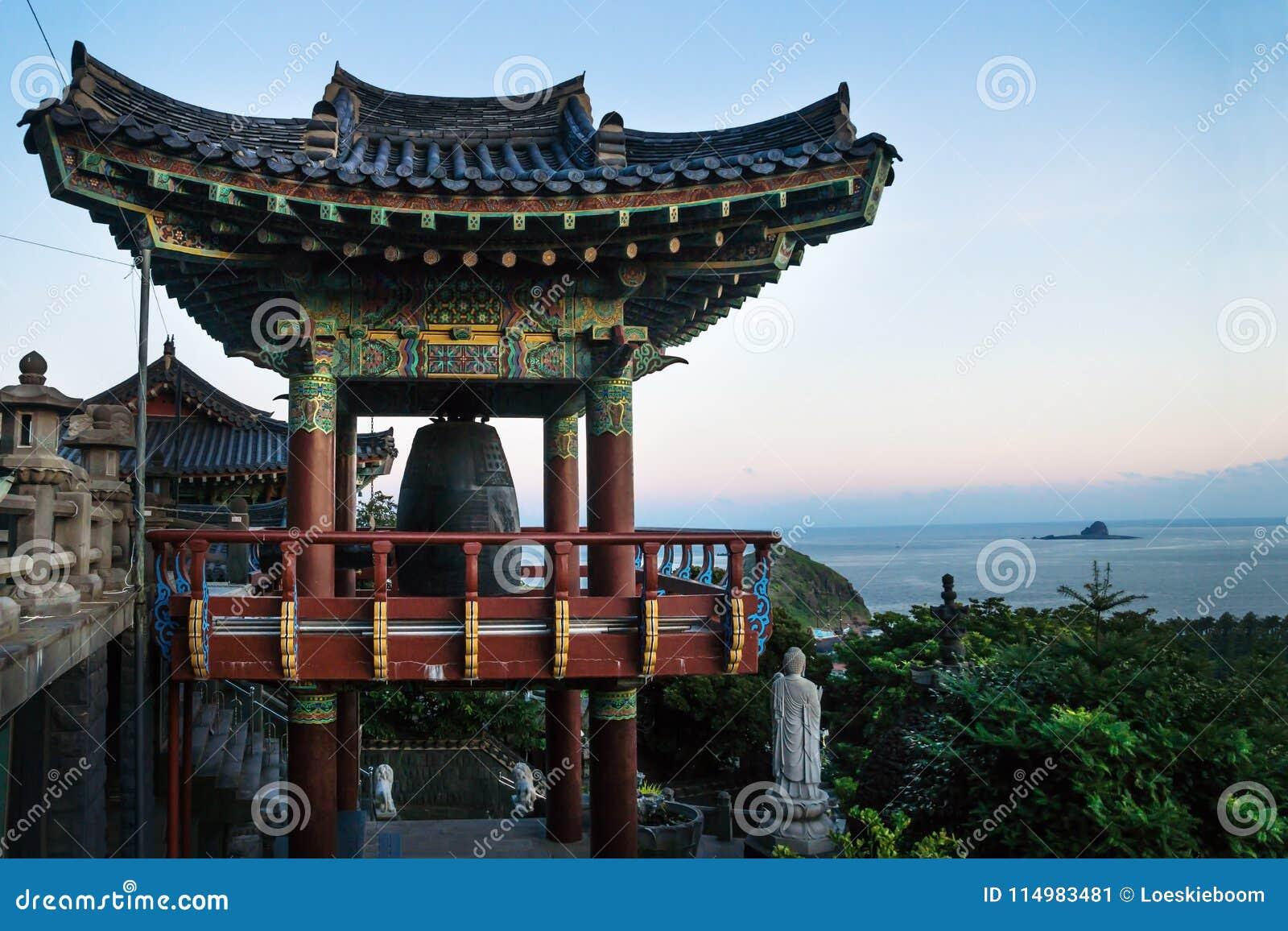 Temple house with bell at Sanbanggulsa temple after sunset, Sanbang-ro, Jeju Island, South Korea