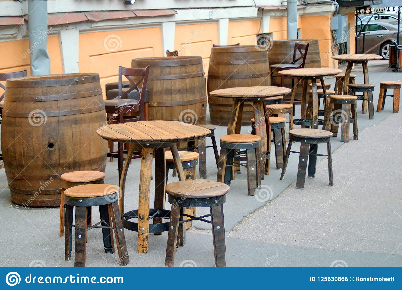 Temporary Street Cafe With Retro Chairs And Tables Made Of