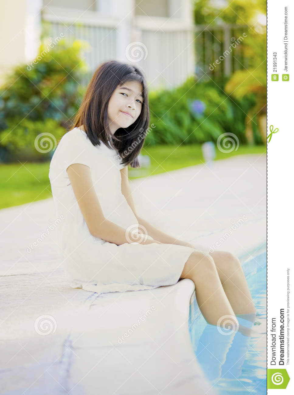 Ten Year Old Girl Repaxing By Pool Stock Photos - Image