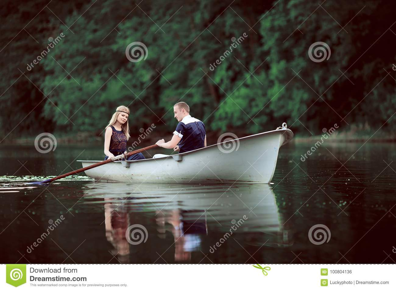Tender couple boating on river