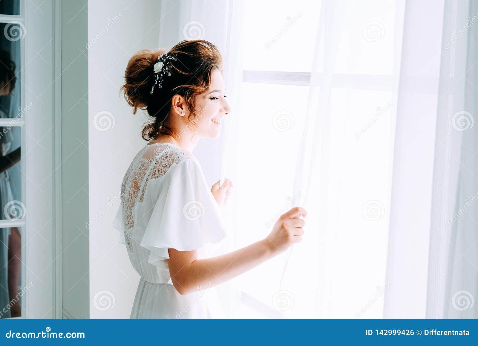 a2d617c48d7 Tender elegant young brunette bride with hairdo