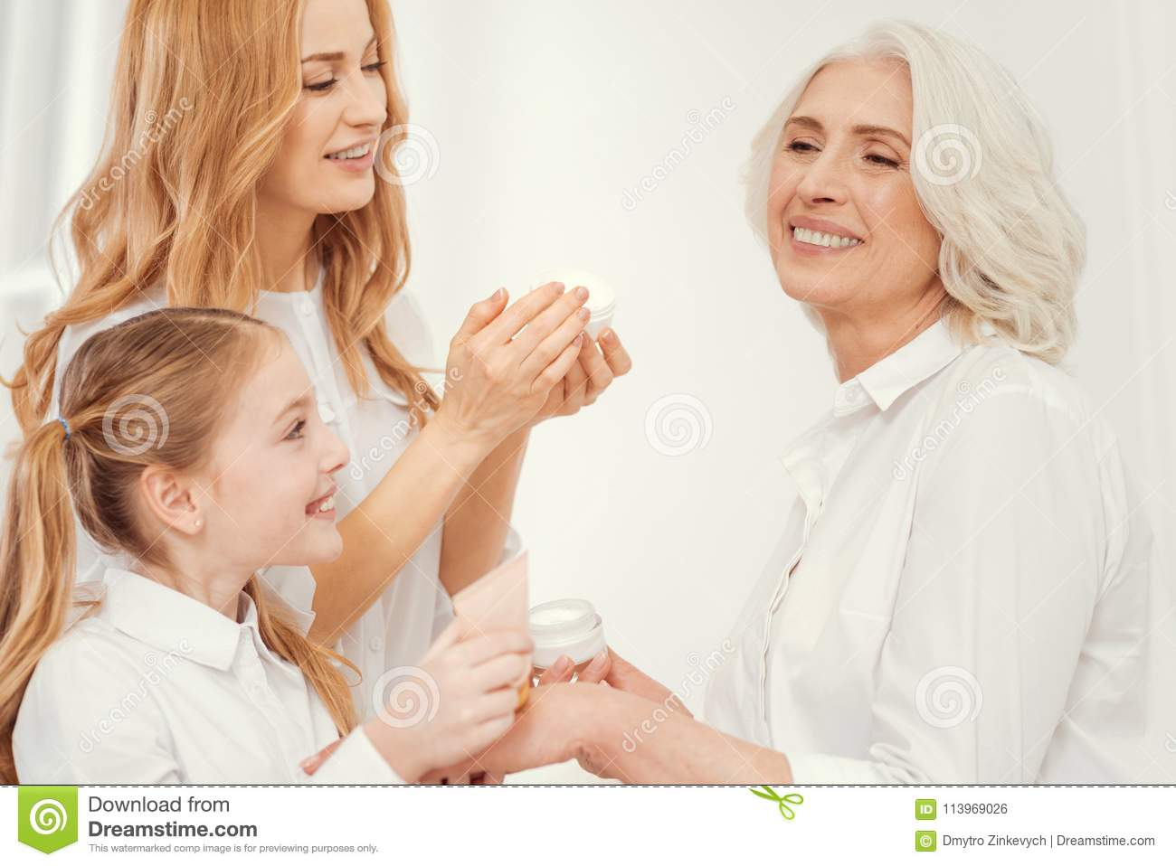 Tender mother and daughter taking care of beautiful grandmother