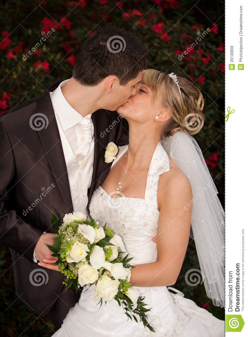 Tender wedding kiss red roses royalty free stock image image royalty free stock photo download tender wedding kiss junglespirit Image collections